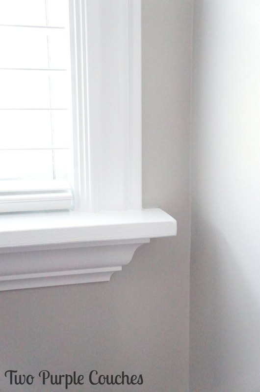 window trim detail - Two Purple Couches