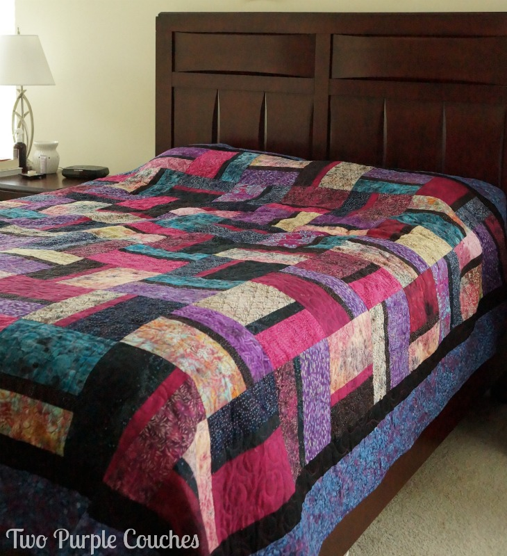 This queen size quilt was handmade by my mom and I for my bedroom. We chose a pattern of alternating rectangles and used all batik fabrics. www.twopurplecouches.com