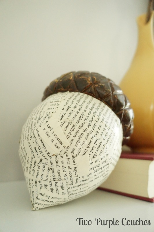"Add interest to a plain plastic acorn using 1"" strips of book pages and Mod Podge. via www.twopurplecouches.com #fall #falldecor #mantels #homedecor #modpodge"
