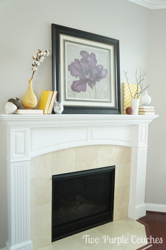 Bright and cheerful Fall-inspired mantel. via www.twopurplecouches.com #fall #falldecor #mantels #homedecor