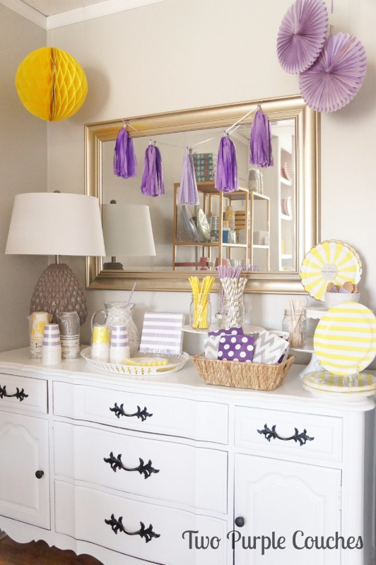 Love this bright and colorful party buffet! Plenty of purples and yellows plus a splash of gray. Styled for Celebrate by Kate in Madeira, Ohio. via www.twopurplecouches.com #celebratebykate #partytime #letsparty #purpleparty #yellowparty #partydecor