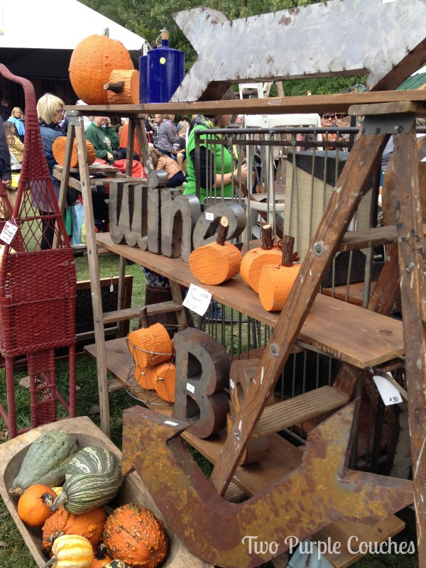 Neat vendor booth with wood slice pumpkins at the Country Living Fair in Columbus Ohio. via www.twopurplecouches.com #CLFair #CountryLiving #Fall #Fairs #columbus #ohio #pumpkins