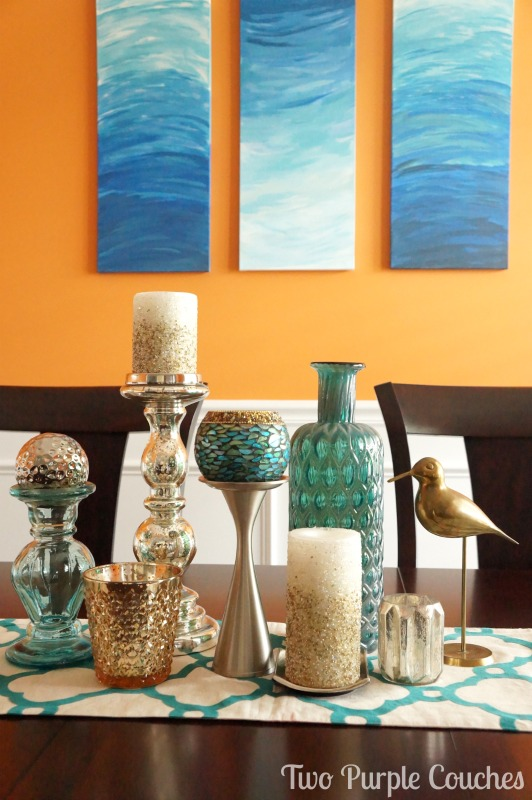 Bold orange and teal dining room decor and accessories. via www.twopurplecouches.com #homedecor #diningroom #orange #teal #color