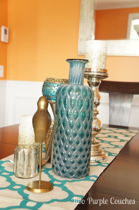 Bold dining room color palette: orange & teal. via www.twopurplecouches.com #homedecor #diningroom #orange #teal #color