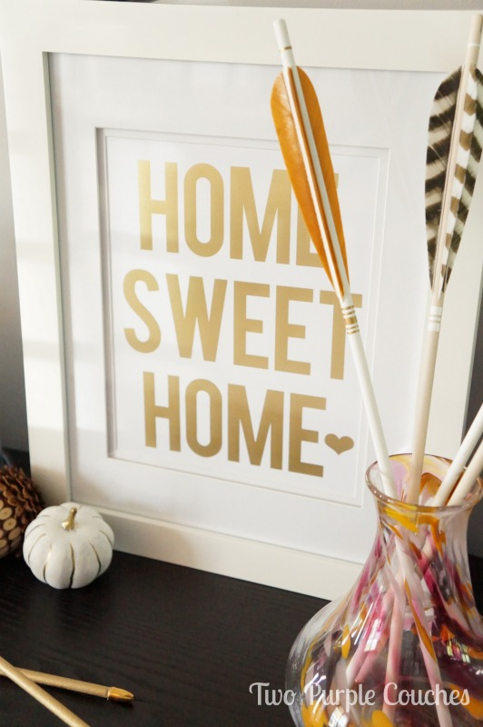 Love the gold print paired with those amazing feather arrows! via www.twopurplecouches.com