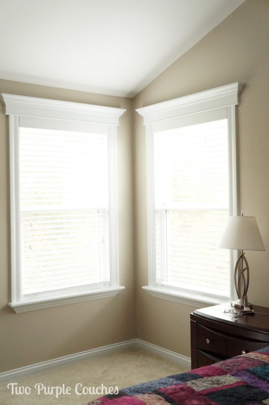 Amazing DIY trimmed windows. Love this custom look! via www.twopurplecouches.com
