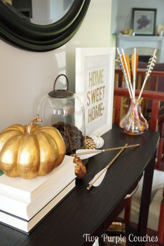 Love the gold accents in this beautiful Fall entry console tablescape! via www.twopurplecouches.com
