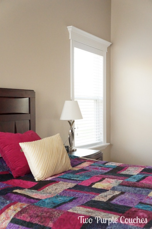 Chic and colorful bedroom makeover. Love this soft, creamy color! via www.twopurplecouches.com