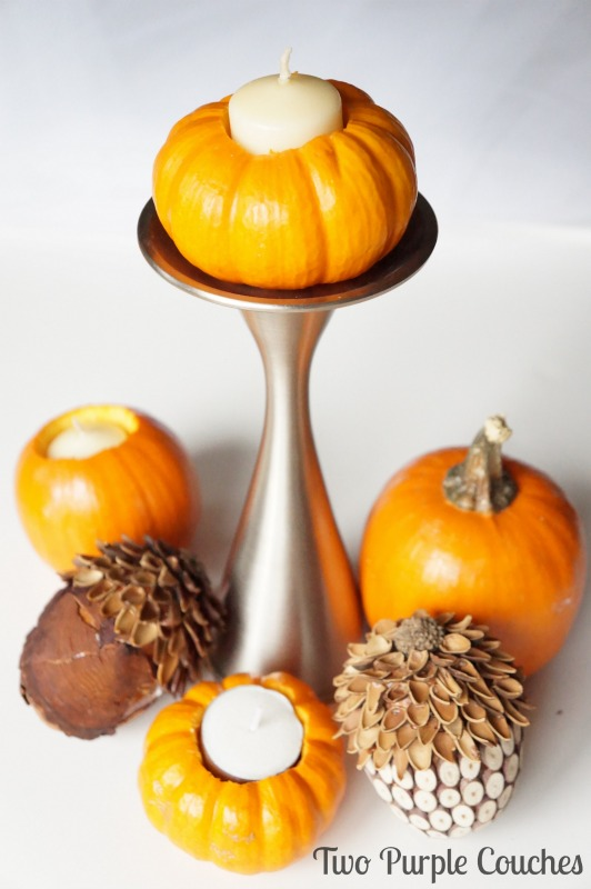 Create a beautiful Thanksgiving centerpiece by turning mini pumpkins into candle holders! Easy step-by-step tutorial included. via www.twopurplecouches.com