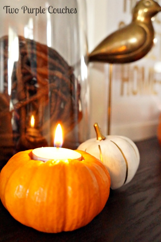 Love this so much for Thanksgiving decorating! Mini pumpkins made into candle holders! Tutorial included. via www.twopurplecouches.com