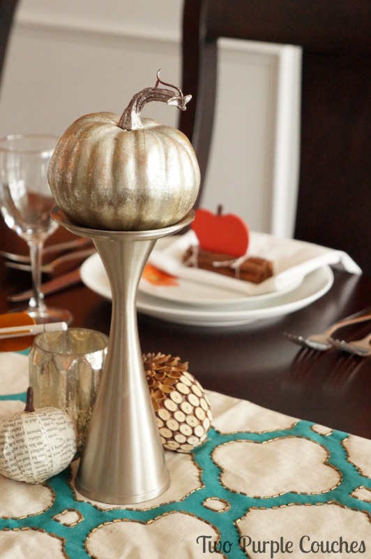 Beautiful metallic pumpkins and accents make this Thanksgiving table feel bright and modern. via www.twopurplecouches.com