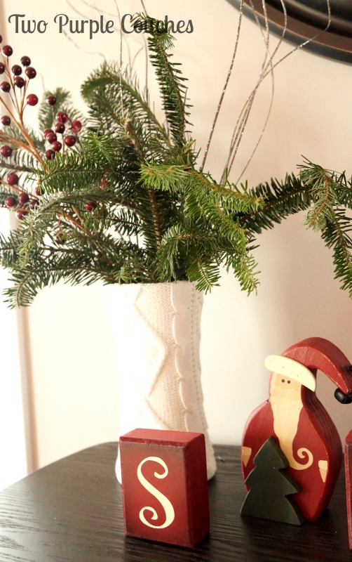 Clip fresh greenery and place in a sweater-covered vase for simple wintery decor. via www.twopurplecouches.com