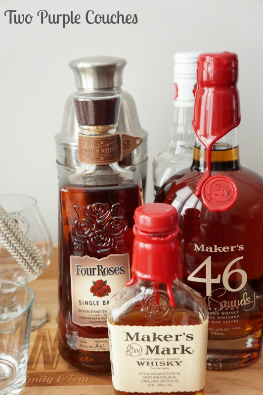 Gather a few bottles of bourbon, or your favorite liquor, to create your own tasting bar. via www.twopurplecouches.com