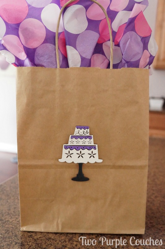 Create your own gift bags with wood embellishments. DIY Birthday Gift Bag via www.twopurplecouches.com