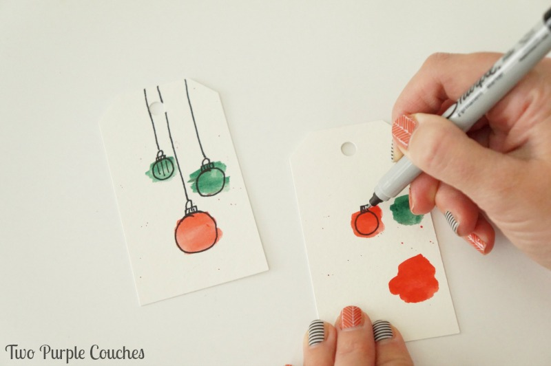 How easy is this!? Paint circles with watercolors, then draw on ornaments for a cute handmade gift tag.
