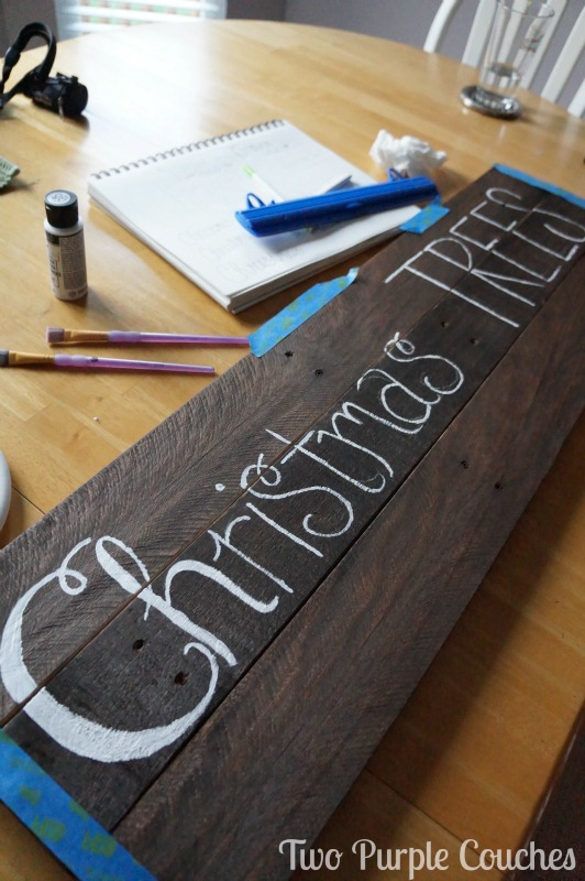 hand-lettering a pallet wood sign