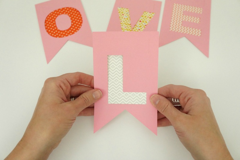 layering washi tape and construction paper banner
