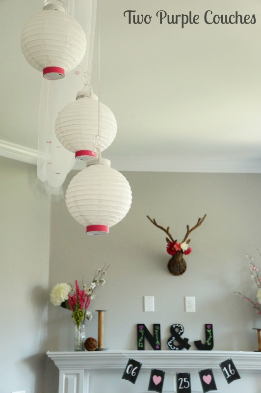 Whimsical paper lanterns and tulle - perfect accents for a pretty garden party bridal shower.