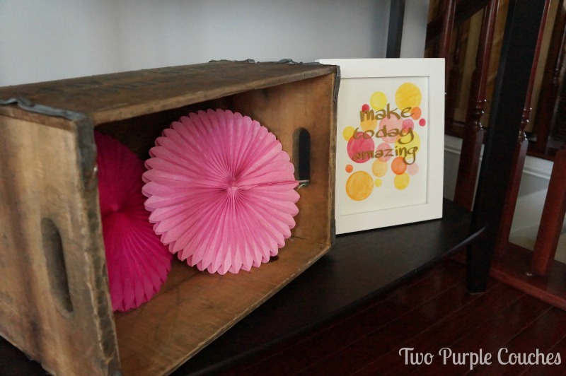 Vintage drink crate and tissue paper rosettes party decor