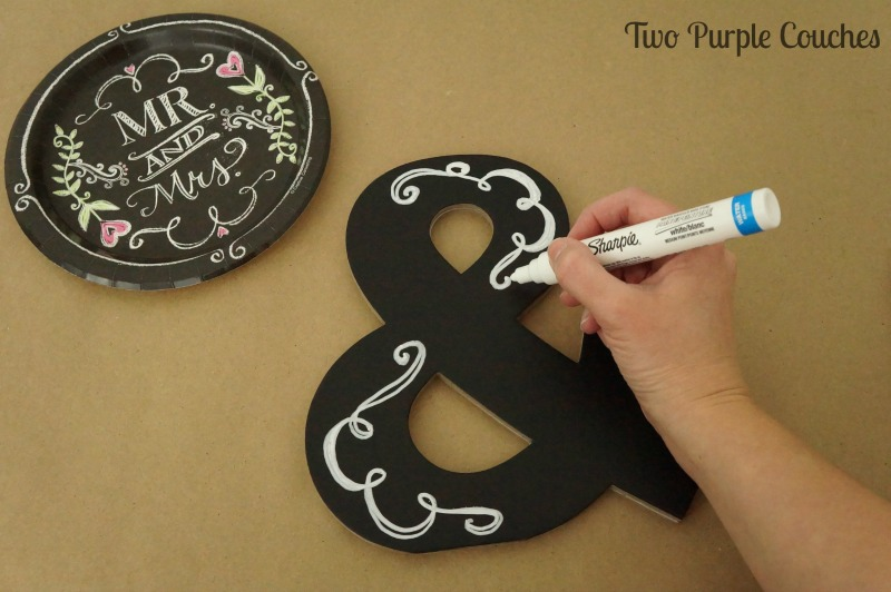 Add flourishes to a chalkboard-style monogram using a paint pen.