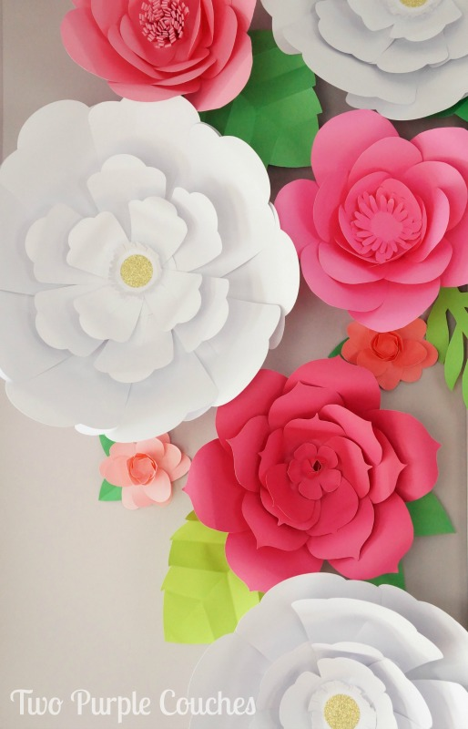 Absolutely stunning DIY paper flower backdrop. Love this idea for a shower, party or wedding!