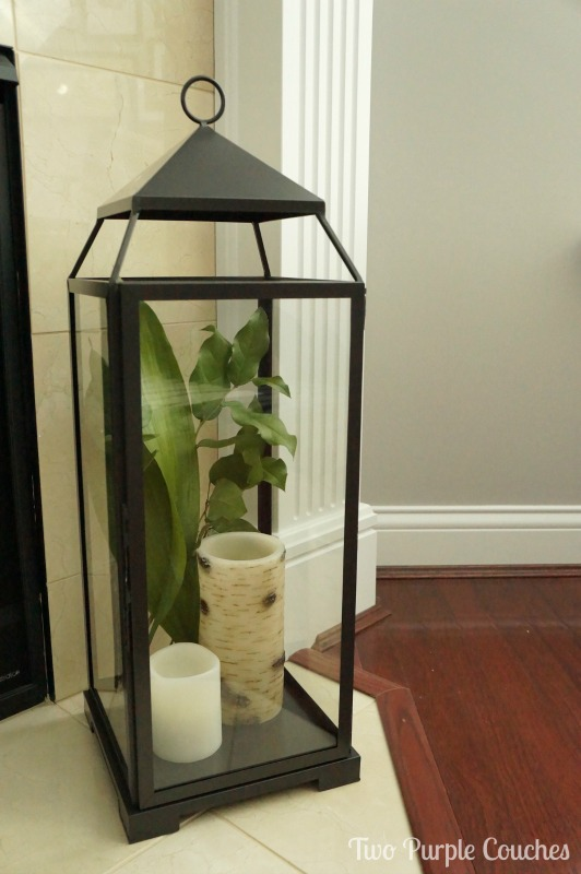 PB Malta lantern styled with candles and greenery for summer