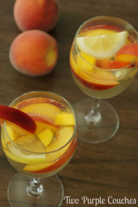 Best summer sangria recipe! This peach sangria recipe combines crisp white wine, peach schnapps and ginger simple syrup for a sweet, refreshing spritzer.