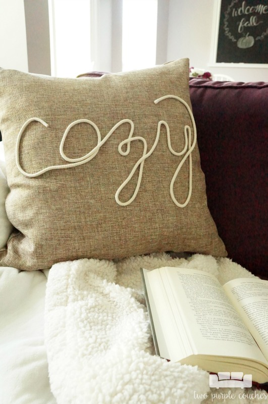 "Create your own ""cozy"" DIY fall pillow cover with this simple technique using rope trim and hot glue! This idea is perfect for fall or winter decorating!"