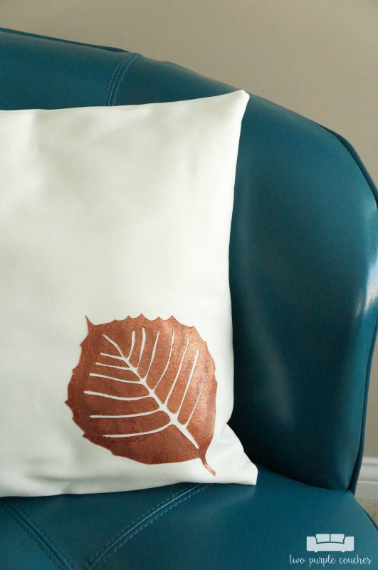 Learn how to use your cutting machine to create a stencil and create this fall leaf throw pillow! An easy way to update throw pillows for each season!
