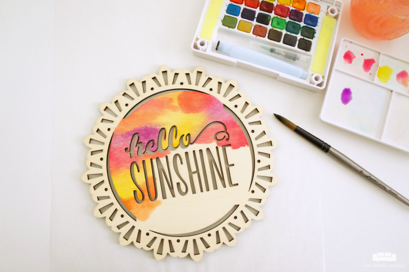 Did you know you can use watercolor paints on wood? Use inexpensive store-bought signs to create your own wood plaque art for your home!