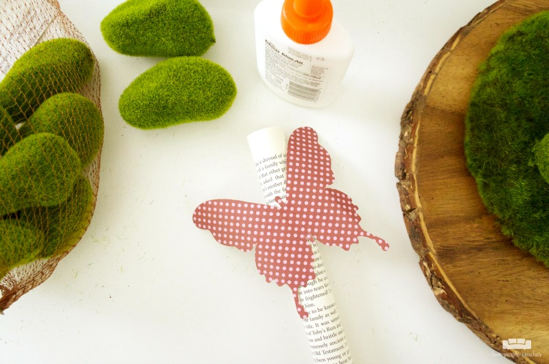 How to make your own simple spring cloche decor with butterflies and moss.