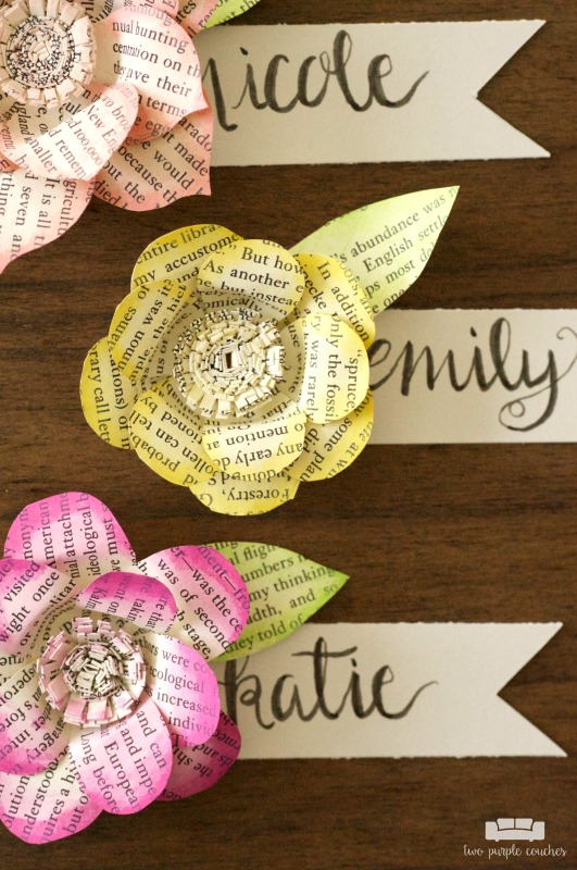 Make your next brunch, shower or event extra special with these beautiful DIY book page flower place cards. Gorgeous and creative name cards for a bridal shower, baby shower or Mother's Day.
