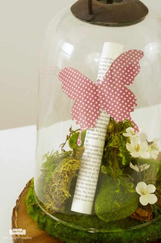 Create a beautiful centerpiece for your home with this simple spring butterfly cloche decor idea. Just add flowers, moss and butterflies!