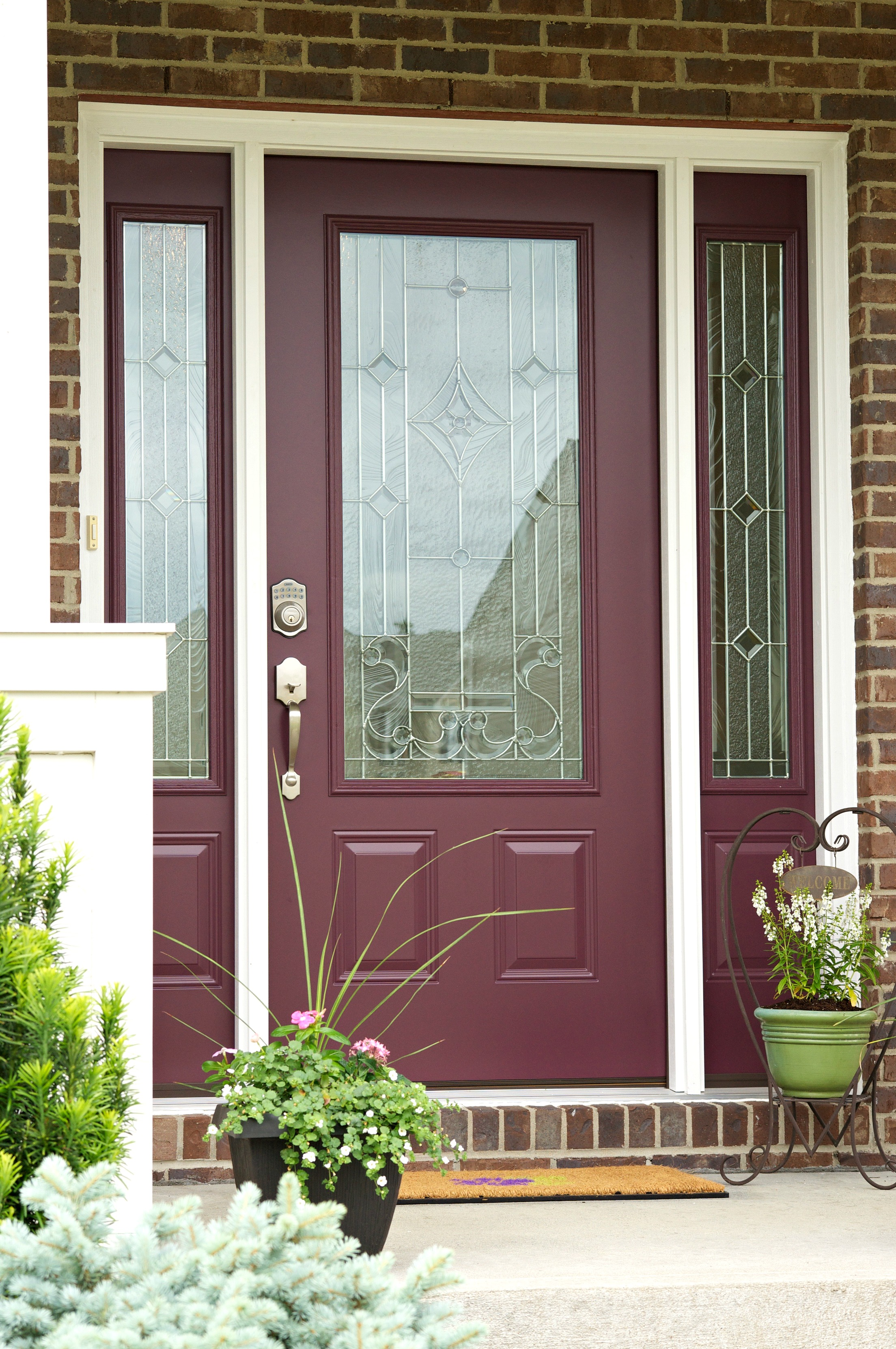 Wow! You've got to see this before and after! This new decorative glass front door adds so much style and curb appeal to this home!