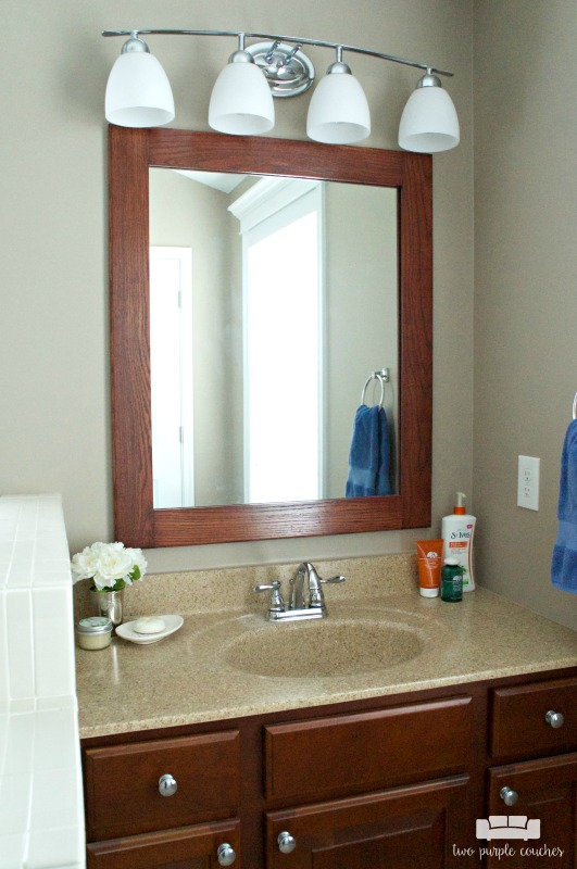 Master Bath vanity area with DIY framed mirror and updated vanity lights.