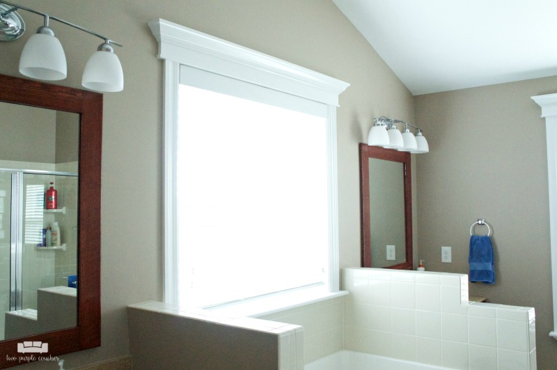 Master Bath with double vanity. Custom framed window above garden soaking tub.