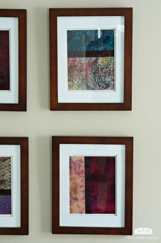Detail of framed batik fabrics in this simple gallery wall master bedroom tour