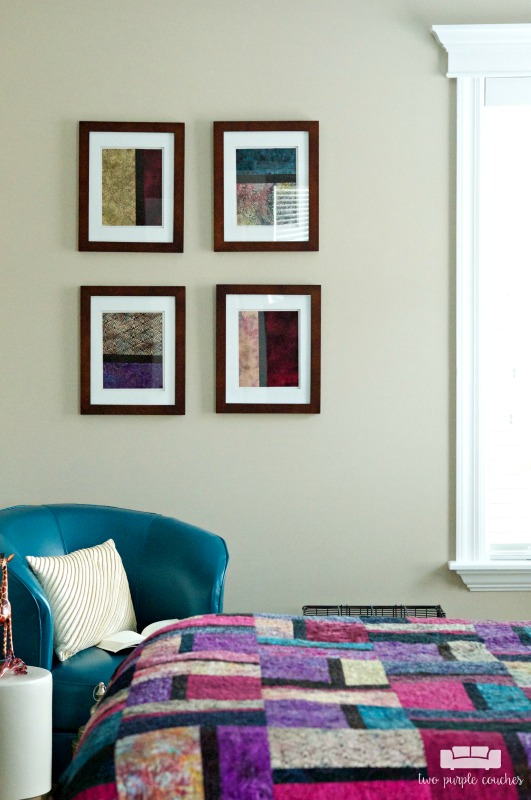 Easy wall decor - frame interesting fabrics to create a gallery wall in this master bedroom tour