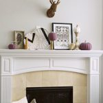 Fall mantel decorations get a modern, tribal inspired makeover with simple neutral accents and colorful purple pumpkins. Try these DIY ideas in your home!