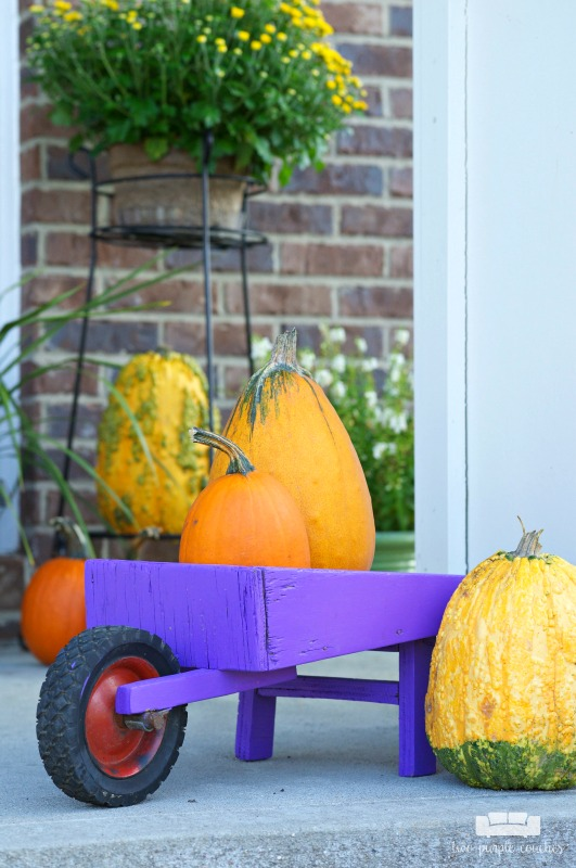 Fall porch decorating idea - Fill a vintage wheelbarrow with small pumpkins!