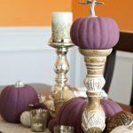 Fall table decor goes sophisticated with these simple ideas. Dress up a modern neutral runner, add candles and pumpkins to create a pretty tablescape.