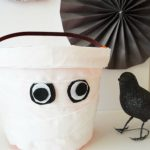Send your trick-or-treaters off with these adorable DIY Mummy Treat Buckets. This easy Halloween project can be made with just a few simple supplies!