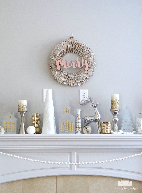 This Christmas mantel decor creates a gorgeous, elegant look with neutral metallics using a beautiful blend of white, silver, gold and mercury glass.