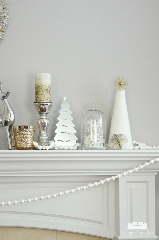 Beautiful neutral metallic Christmas mantel decorations