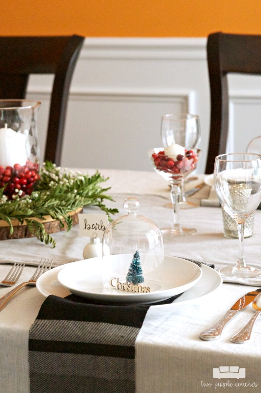 Christmas table decor goes elegant and simple with these natural and inexpensive ideas. Learn how to DIY a beautiful holiday centerpiece and table setting.