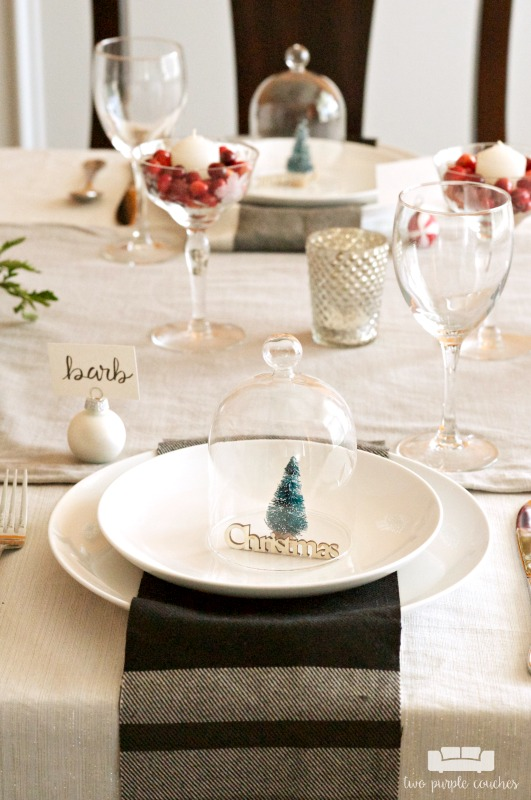 I love this simple place setting for Christmas and the holidays! White plates, plaid napkins and a bottlebrush tree! So cute!