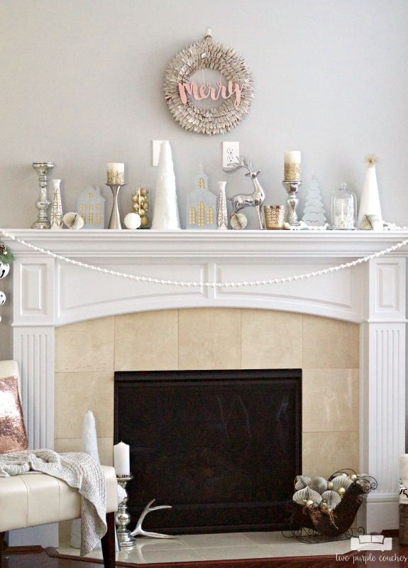 Gorgeous holiday mantel with a pretty modern wreath