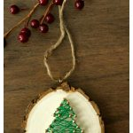DIY Christmas Tree String Art Ornaments are a fun handmade holiday craft. Follow this simple tutorial to make your own rustic wood slice ornament!