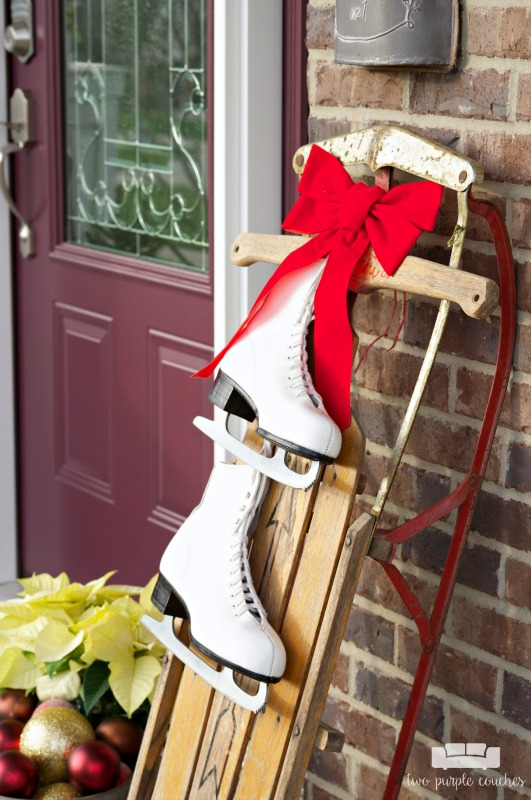 Great idea! Add a pair of ice skates to a vintage sled for outdoor holiday porch decorating!