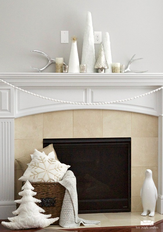 Gorgeous winter white mantel decor!